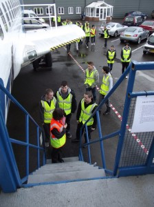 Julie A.Rushton leads another group of students onboard the B737 Aircraft